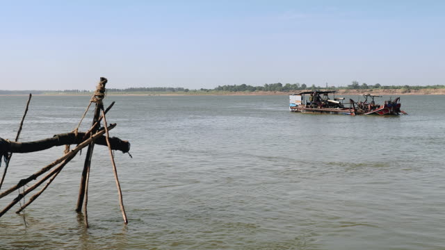 dredging boat filled with riverbed sand reaching the riverside dredging boat filled with riverbed sand reaching the riverside pipe connector stock videos & royalty-free footage