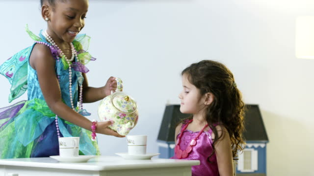 Dress Up Little girls having a tea party.  dressing up stock videos & royalty-free footage