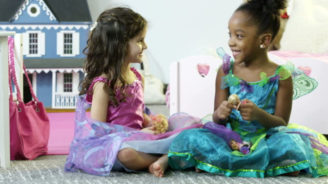 Dress Up Little girls playing with dolls.  dressing up stock videos & royalty-free footage
