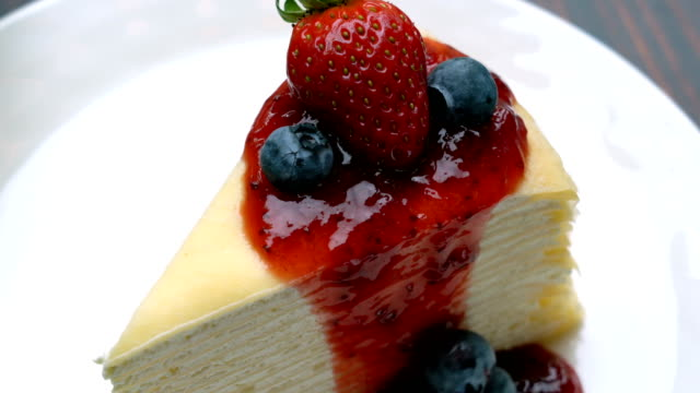 Dressing Crepe Cake with Stawberry Sauce and Fresh Stawberry, Blueberry on Top video