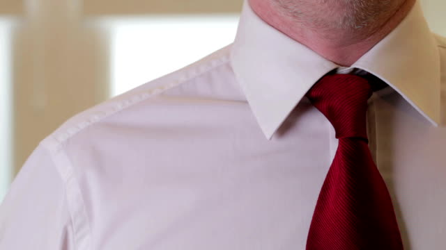 Dressing for business jacket and tie video