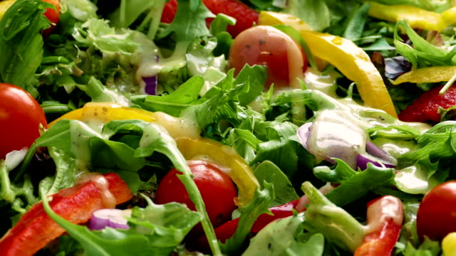 dressing poured on fresh salad - insalata video stock e b–roll