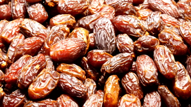 dried fruits or dates on the counter close up - ramadan stock videos and b-roll footage