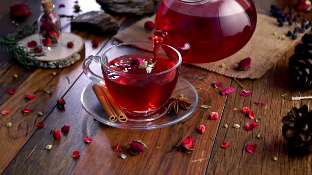 dried rose herbal tea on wooden background - disintossicazione video stock e b–roll