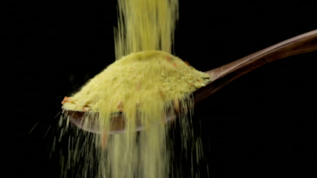 Dried spice Dried spice is falling into a wooden spoon celery stock videos & royalty-free footage