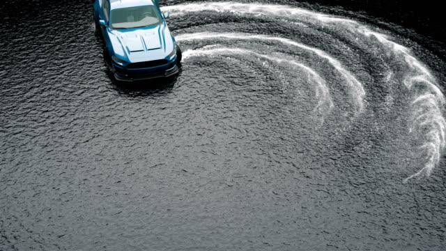 vídeos y material grabado en eventos de stock de coche deportivo a la deriva sobre el agua sobre el asfalto mojado. salpicadura y espuma de las ruedas giratorias. - nieve amontonada