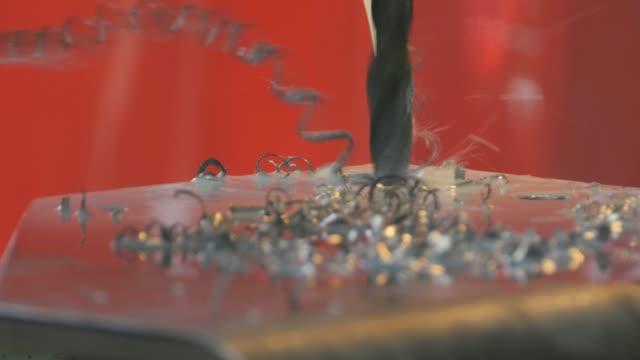 Drill bit drilling through Metal Plate video