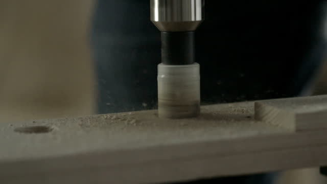 Drilling a hole in a piece of wood video