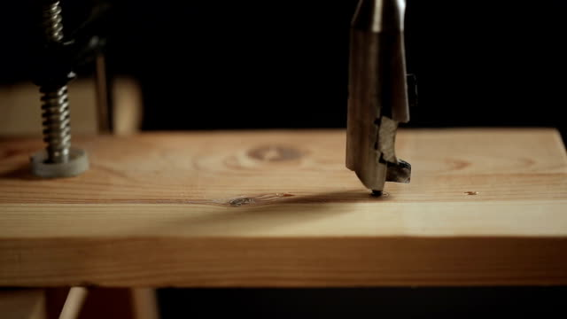 Drilling a hole in wood plank video