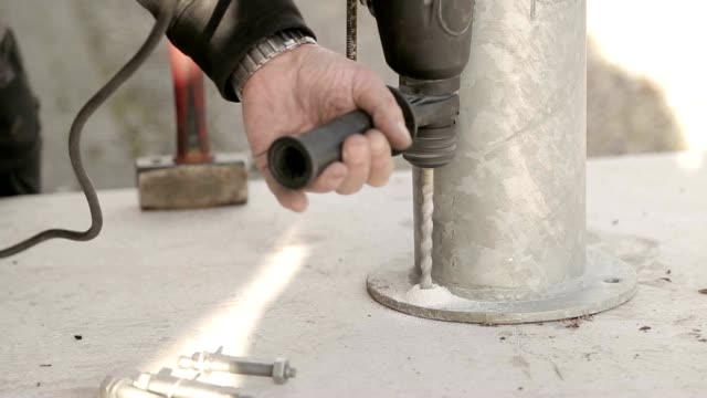 Drilling hole in concrete with hammer drill video