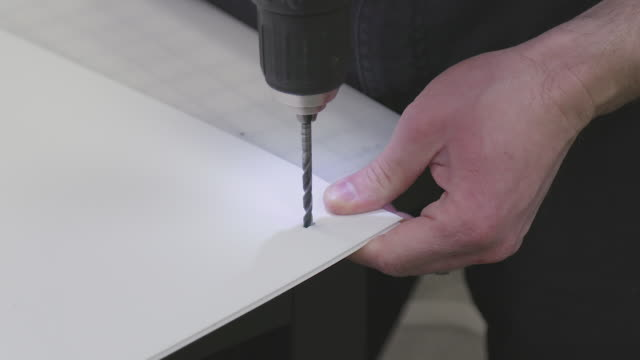 Drilling Hole into Poster Board with Electric Drill