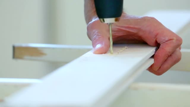 drilling holes in the wooden board electric drill video