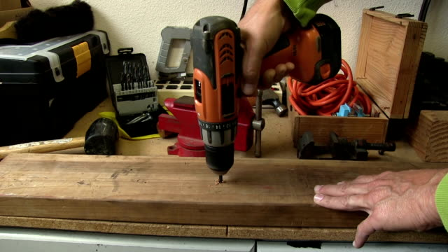 Drilling into a wooden workbench video
