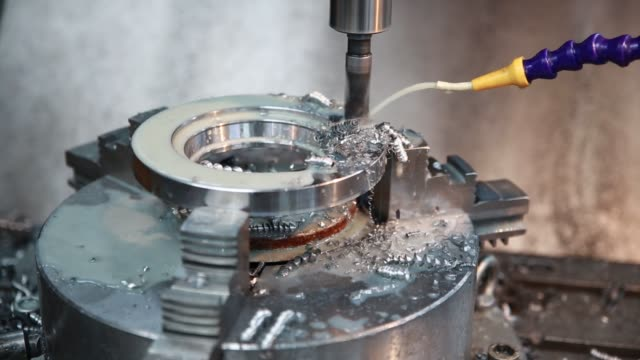 Drilling machine makes a hole in the metal product. Drilling machine makes a hole in the metal product. Coolant is pouring on the drill. metal worker stock videos & royalty-free footage