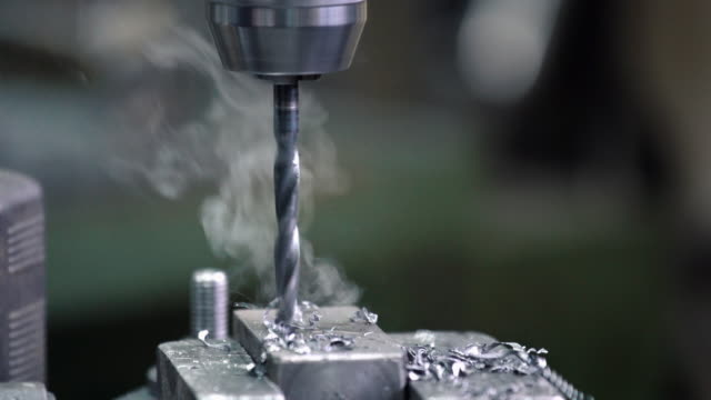 Drilling metal 4k. video