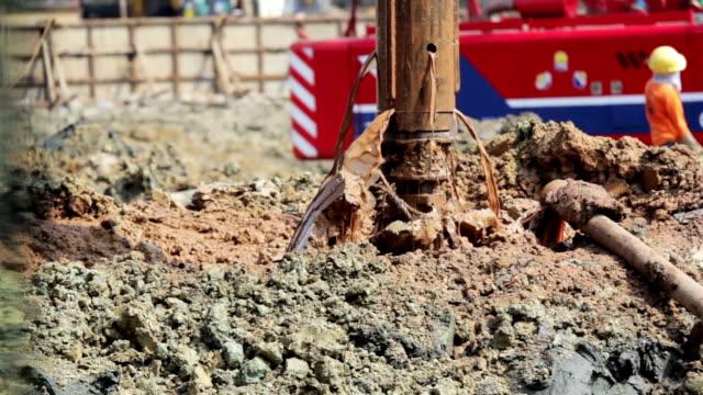 Drilling soil machine on Construction site,Tilt down shot video