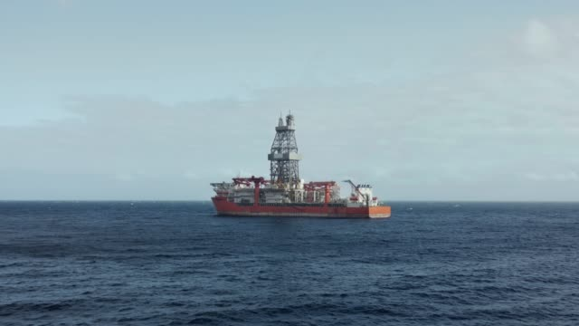 Drilling vessel exploring new oil and gas fields in the ocean Typical drill ship for exploration, drilling and production of oil and gas from offshore fields crane construction machinery stock videos & royalty-free footage