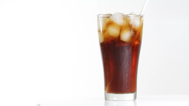 drink cola by straw - sugrör bildbanksvideor och videomaterial från bakom kulisserna