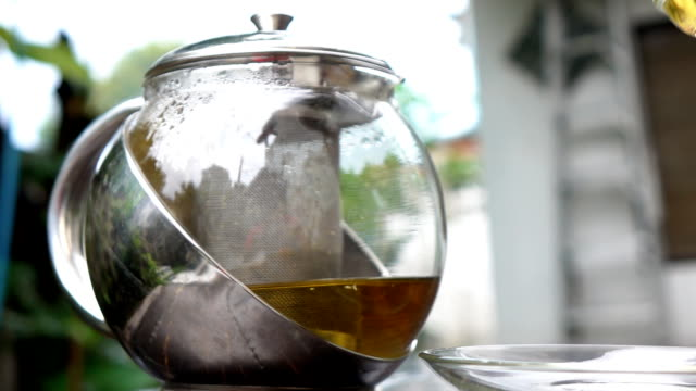 Drinking chamomile tea in slow motion video