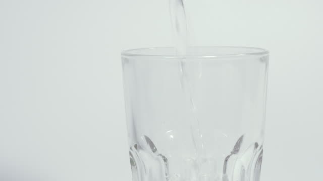drinking water. drinking water is poured into a glass. - decanter video stock e b–roll