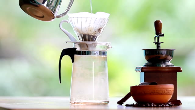 Drip coffee Process. Pouring a boiling water over the grounds. video