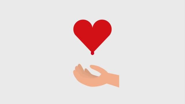 vídeos de stock e filmes b-roll de dripping blood in hand heart donation - blood donation