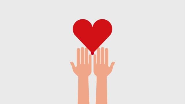 vídeos de stock e filmes b-roll de dripping heart blood in hands donation - blood donation