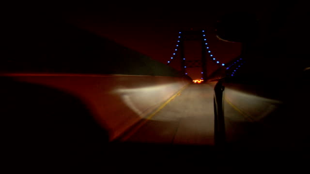 Drive across bridge at night This is a car mount POV shot driving across a bridge, and exiting.  The footage is slightly sped up. chasing stock videos & royalty-free footage
