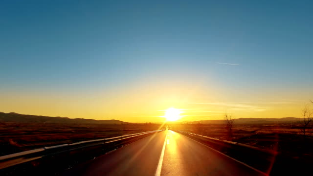 kör pov på strait road mot solnedgången - bilperspektiv bildbanksvideor och videomaterial från bakom kulisserna