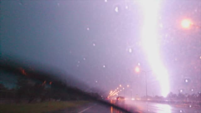 drive in rain and lightning - fulmine video stock e b–roll