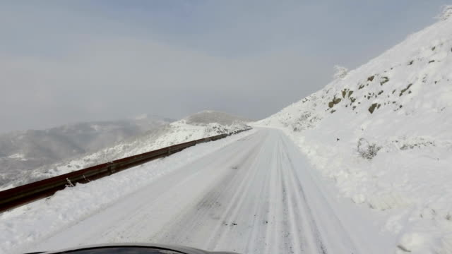 POV drive on snow covered mountain rural road video