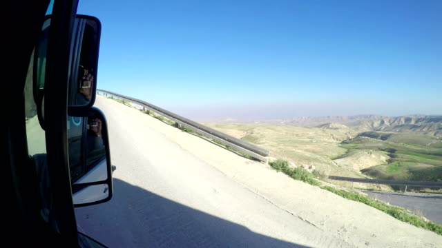 Drive pov oin Winding Asphalt Road in the Negev Desert in Israel, Instagram Effect