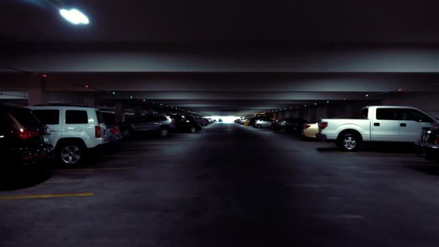 POV drive through underground parking garage in slow motion 120fps