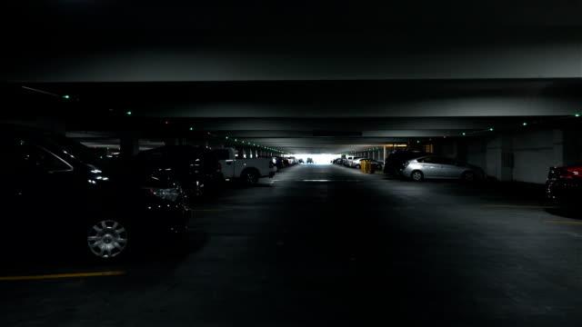POV drive through underground parking garage in slow motion 120fps video