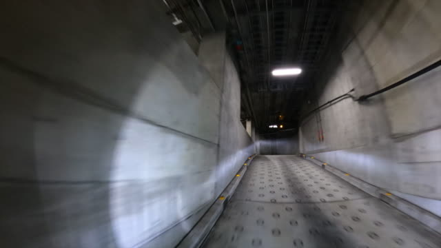 drive through underground parking garage - basement stock videos & royalty-free footage
