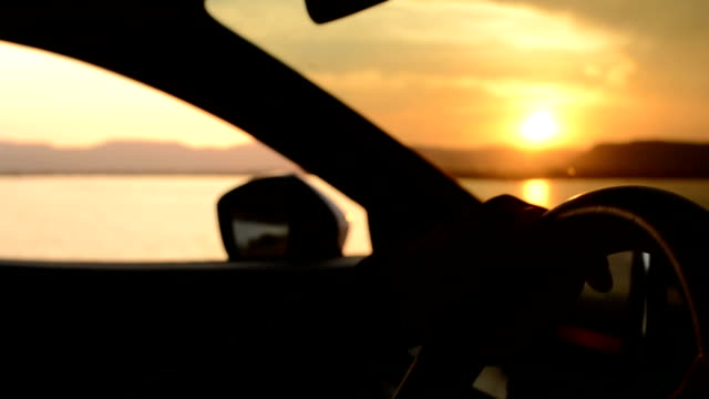 Driver at sunset Driver luxury car stock videos & royalty-free footage