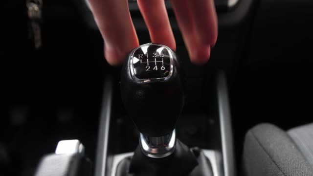 Driver Changing Gears with Manual Transmission Gear Stick Driver Changing Gears with Manual Transmission Gear Stick cycle vehicle stock videos & royalty-free footage
