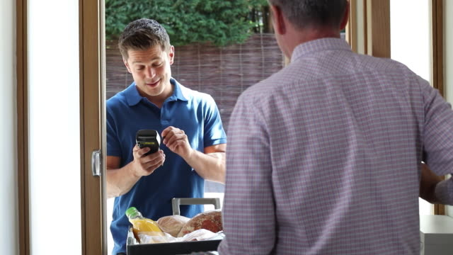 driver delivering online grocery order to house - grocery home video stock e b–roll
