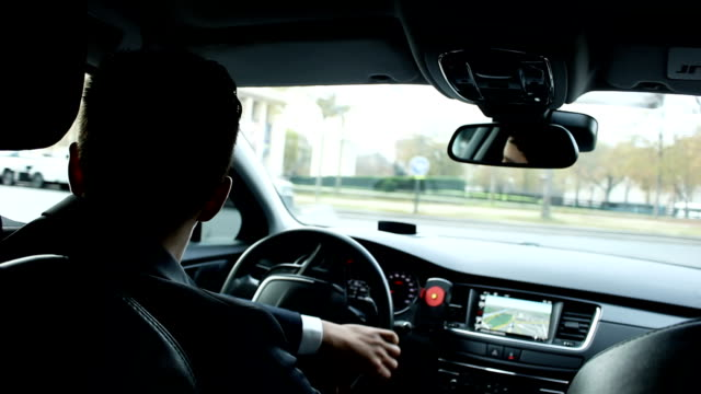 Driver drives a car in the central part of Paris Personal driver drives a car in the central part of Paris, view from interior dashboard vehicle part stock videos & royalty-free footage