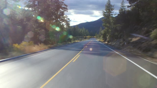 Driver's POV on highway with oncoming traffic, California, USA, shot on R3D
