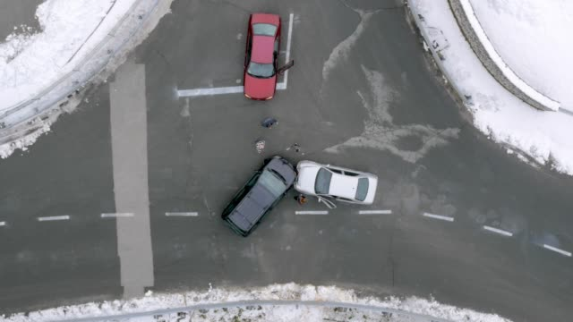 AERIAL Drivers stepping out of the cars at the scene of a car accident Aerial shot of the drivers stepping out of their vehicles at the scene of a car crash in the crossroad. Shot in Slovenia. car accident stock videos & royalty-free footage