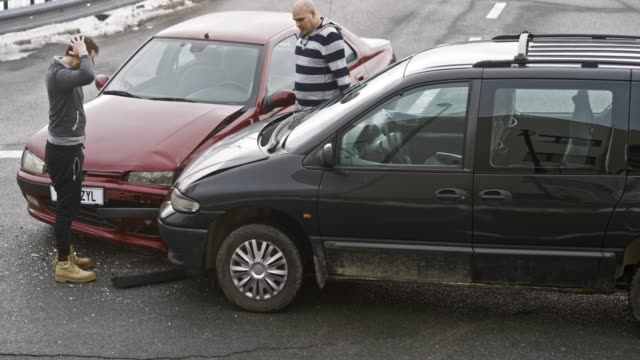 Drivers stepping out of their cars after the car accident to check the damage