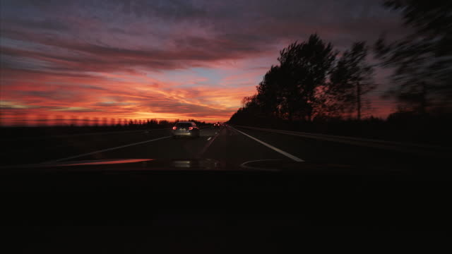 driving a car at sunset. - memories stock videos & royalty-free footage