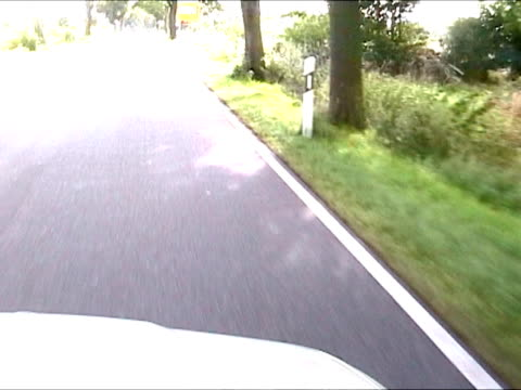 Driving a car in countryside road