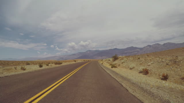 Driving a car in Death Valley scenic roads POV Driving a car in Death Valley roads POV mojave desert stock videos & royalty-free footage