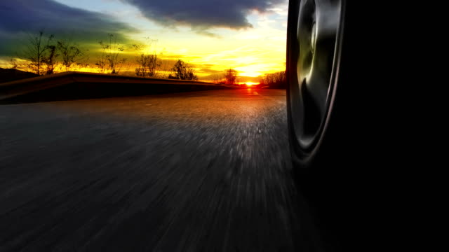 POV  Driving a car on a country road at sunset, sunrise. Fast Speed Race