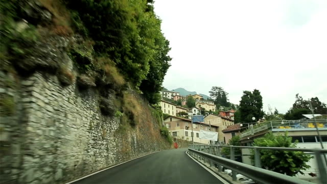 Driving a car on a narrow road. Italy.  POV video