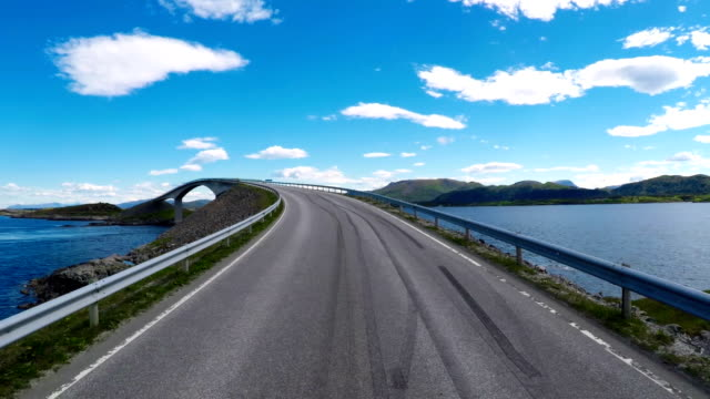 Driving a Car on a Road in Norway Atlantic Ocean Road or the Atlantic Road (Atlanterhavsveien) been awarded the title as (Norwegian Construction of the Century). video