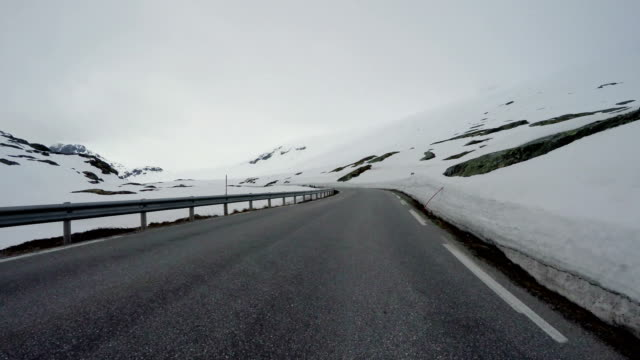 driving a car on a road in norway - strada transitabile video stock e b–roll