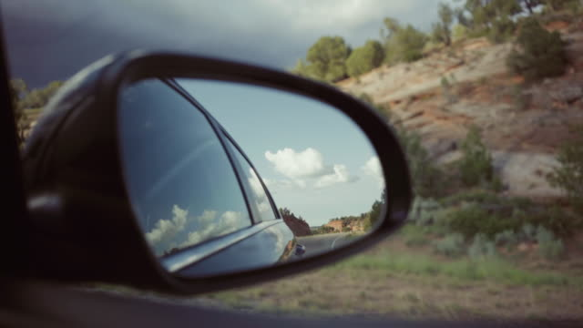 driving a car on desert highway: passenger view - parco statale del red rock canyon video stock e b–roll